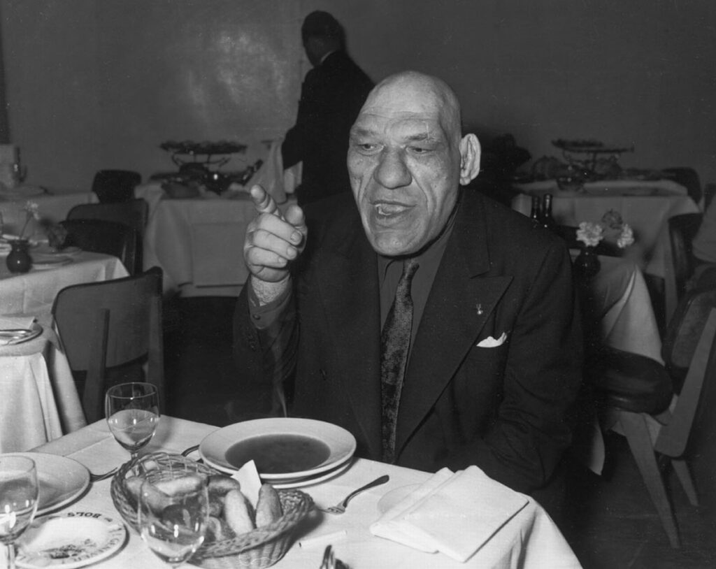 Maurice Tillet enjoying one of his favorite activities, dining outside.